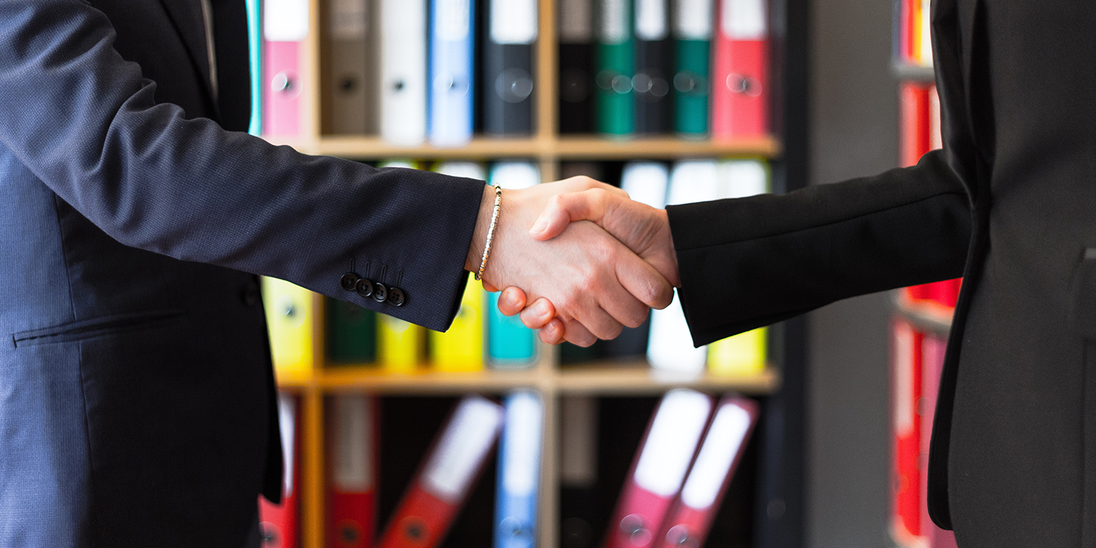 two lawyers shaking hands