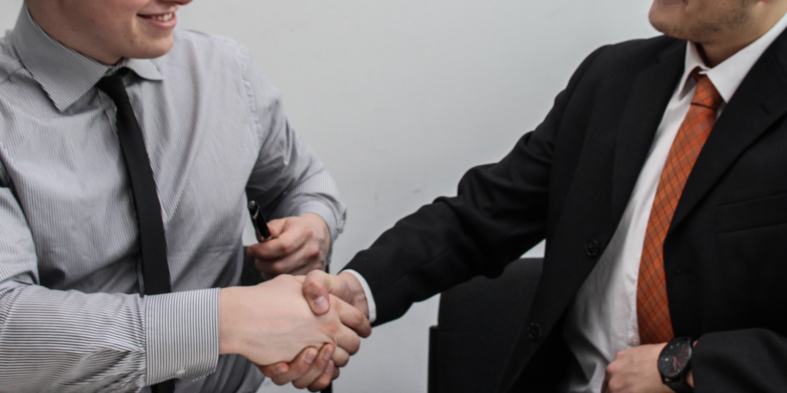 Lawyers shaking hands at an Indiana Law firm